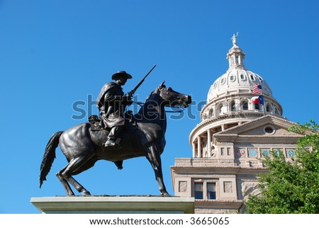 State of Texas Capitol building with a Texas Ranger guarding it at its feet - stock photo