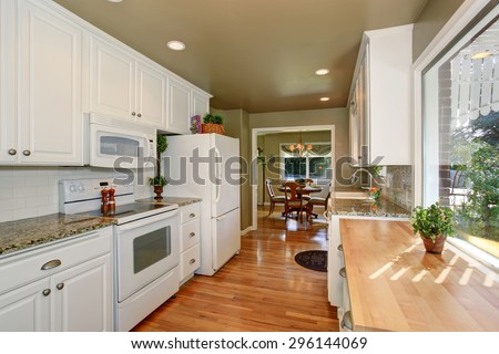 State of the art kitchen with green walls and white accents. - stock photo
