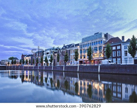 Stately mansions mirrored in a harbor at twilight, Breda, The Netherlands