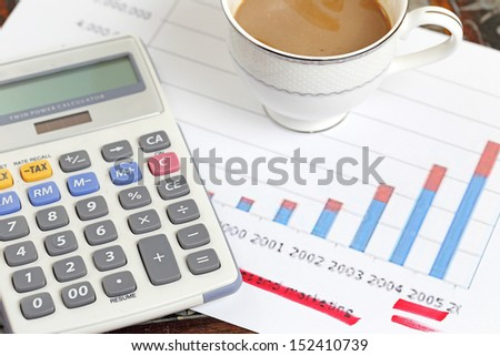 statement with calculator and coffee - stock photo