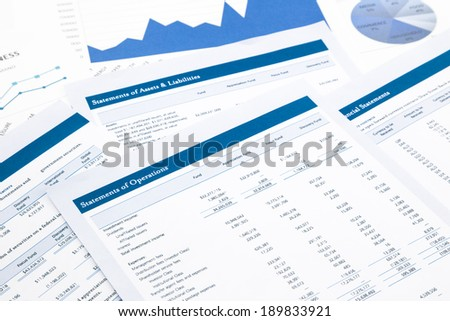 statements of operations, business report and paperwork - stock photo
