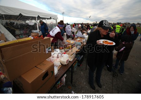 STATEN ISLAND, NEW YORK CITY - NOVEMBER 4 2012: Volunteers & national guard assembled at New Dorp High School to render aid to people recovering from Hurricane Sandy. Hot food for those in need - stock photo