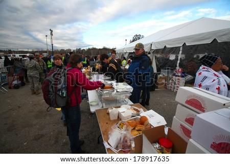STATEN ISLAND, NEW YORK CITY - NOVEMBER 4 2012: Volunteers & national guard assembled at New Dorp High School to render aid to people recovering from Hurricane Sandy. Food supplies distributed - stock photo