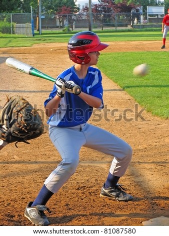 STATEN ISLAND, NY - JUNE 25: Anton Orlov, Staten Island resident, age 13, hits a ball during South Shore Babe Ruth League game on June 25, 2009 in Staten Island, NY. - stock photo