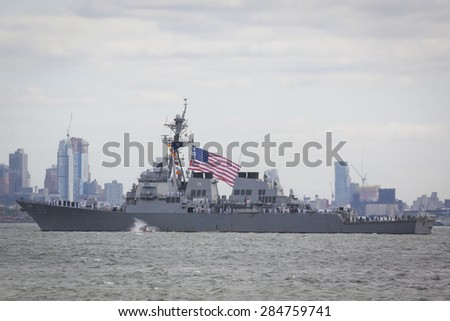 STATEN ISLAND, NY - MAY 20 2015: The American Flag flies from the USS Stout (DDG 55) as the ship travels on the Upper Bay towards Manhattan during the Parade of Ships, which begins Fleet Week.  - stock photo