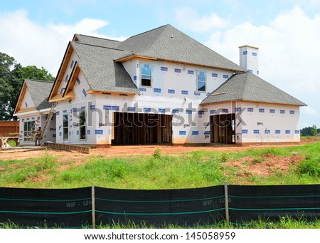 STATHAM, GEORGIA, USA - JULY 7: Home construction is picking up at local counties in Georgia. Shown is a home being constructed on July 7, 2013 in Statham Georgia. - stock photo