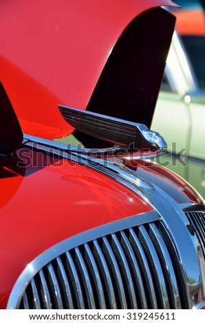 STATHAM, GEORGIA, USA - SEPT 19, 2015: Vintage car hood ornament design displayed at the annual Sun Flower Festival car show at Statham, Georgia. - stock photo