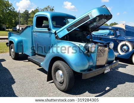 STATHAM, GEORGIA, USA - SEPT 19, 2015: Vintage 1940 pickup truck displayed at the annual Sun Flower Festival at Statham,. Georgia. - stock photo