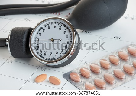 Statins or generic drugs with a glass of water. Health and Medical concept. Logos removed