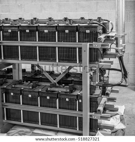 Station battery plant and seismic rack, monochrome image.  Wet cell batteries,  used for switchgear control voltage
