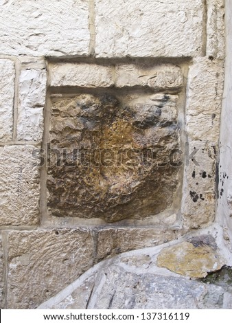 Station 5 of the Stations of the Cross in Via Dolorosa. An old square stone, located on the right side of the structure, has a cavity which is said to be the imprint of Jesus hand. Jerusalem, Israel - stock photo