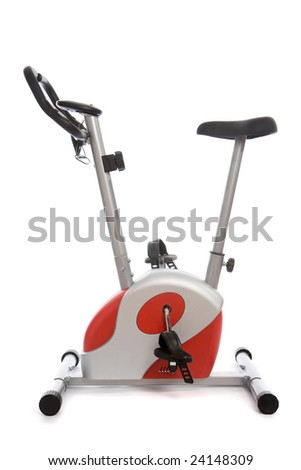 Stationary bike at the gym isolated on white - stock photo