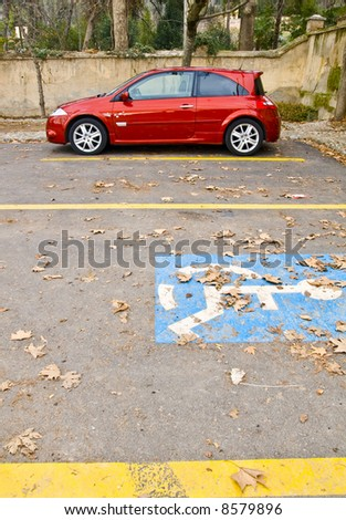 Stationary red car in autumn background - stock photo