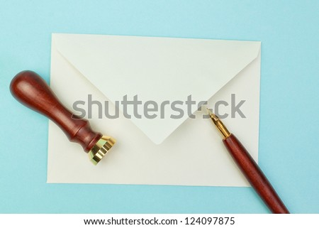 Stationery and office supplies postal envelope on a blue background. - stock photo