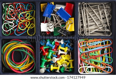 stationery collection in black box surface top view  - stock photo