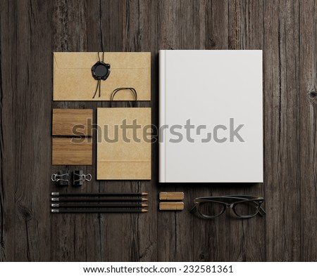 Stationery elements on wood background - stock photo