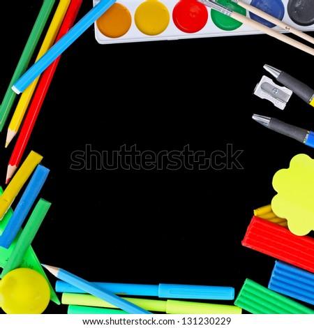 Stationery isolated on a black background. - stock photo