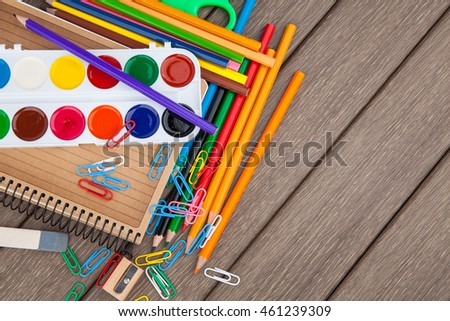 Stationery, office and student accessories on wooden