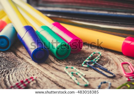 Stationery on a wooden surface.