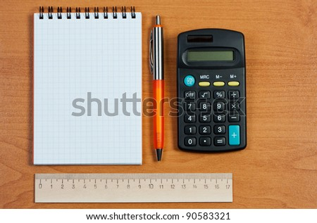 Stationery on wooden background. - stock photo