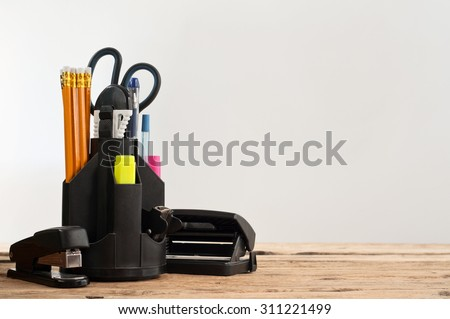Stationery on wooden table on a gray background, closeup. Copy space. Free space for text - stock photo