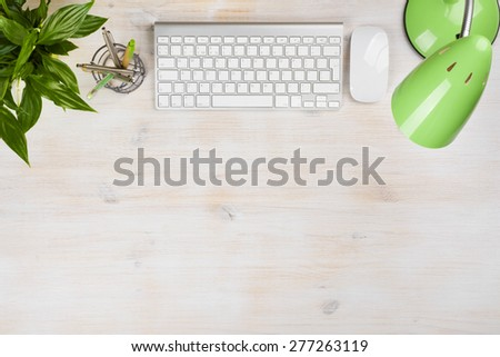 Stationery sapplies, lamp, computer keyboard and mouse on table - stock photo