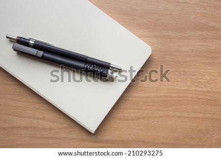 Stationery with white book on table