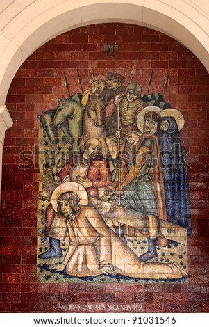 Stations of the Cross:Jesus falls the second time; A panel of Portuguese tiles outside the shrine of Fatima - stock photo