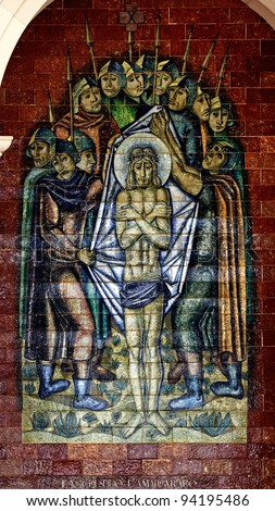 Stations of the Cross:Jesus is stripped and bitter; A panel of Portuguese tiles outside the shrine of Fatima - stock photo