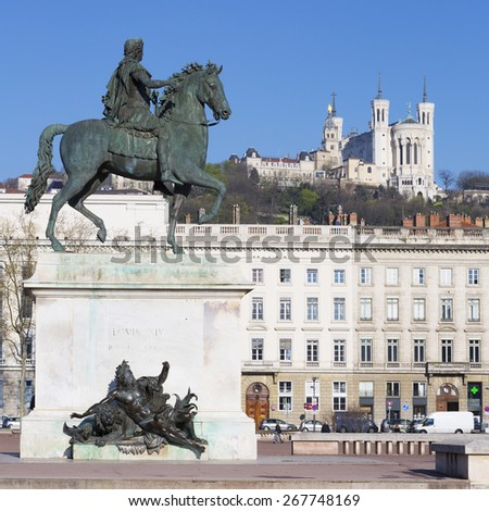Statue  and Basilica on a background, Lyon, France. - stock photo