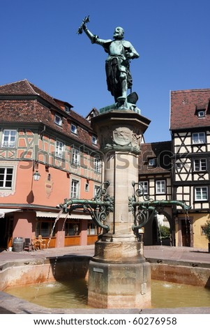 Statue and Fountain in central square of Colmar, France