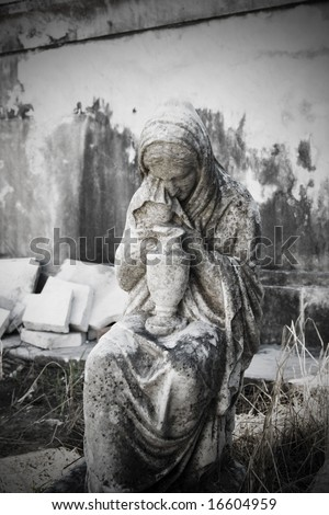 statue at gravesite in Lafayette Cemetery, New Orleans, circa 1860 - stock photo