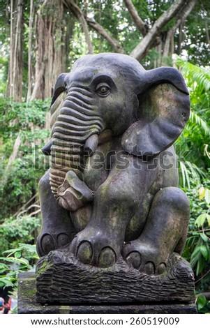Statue at the monkey temple, Ubud, Bali, Indonesia - stock photo