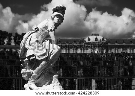 Statue at the Sanssouci palace of Potsdam, Germany with dramatic sky - stock photo