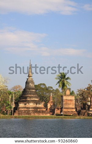 Statue Buddha and Brick Columns in Wat Mahathat in Sukhothai Historical Park, North of Thailand