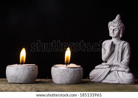 Statue figurine of meditating Gautama Buddha in sitting lotus position - stock photo