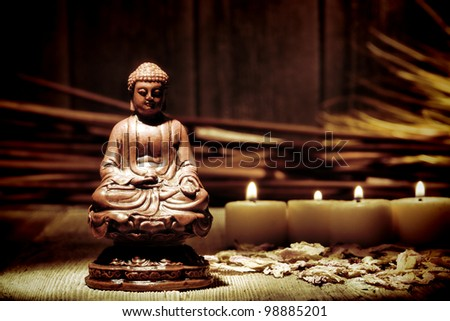 Statue figurine of meditating Gautama Buddha in sitting lotus position for religious observance and spiritual meditation in a makeshift improvised Buddhist religion temple - stock photo
