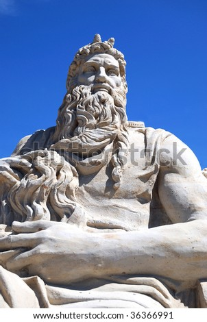 Statue from sand against the blue sky of the mythical hero. - stock photo