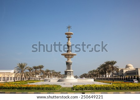 Statue in a roundabout in Sharjah, United Arab Emirates - stock photo