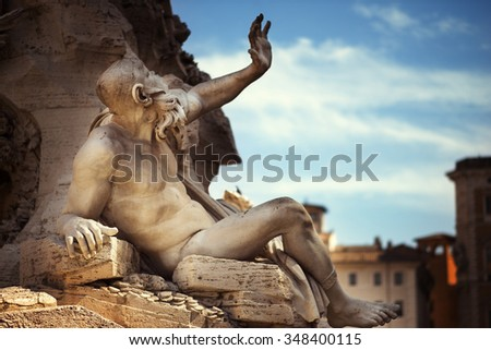 Statue in Fountain, Piazza Navona, Rome, Italy - stock photo