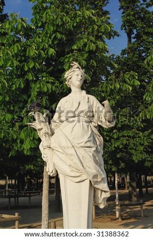Statue in Paris Park - stock photo