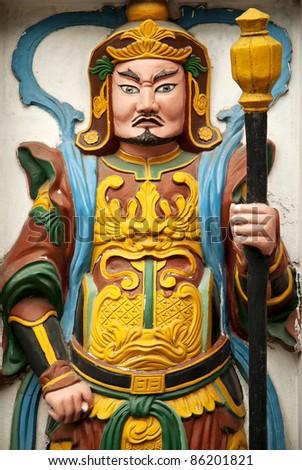 statue in temple wall in hanoi vietnam - stock photo