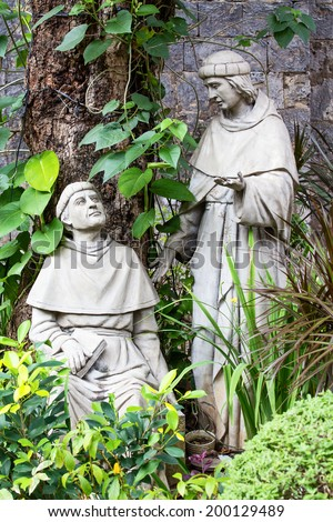 Statue in the courtyard of the old catholic church of the Basilica del Santo Nino. Cebu, Philippines. - stock photo