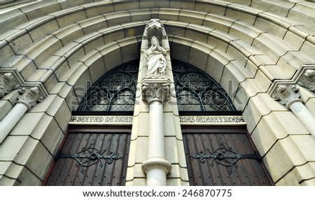 Statue in top of the entrance of  St. Marry Cathedral, Jakarta, Indonesia. - stock photo
