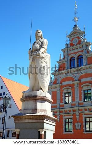 Statue near House of the Blackheads. Riga, Latvia - stock photo