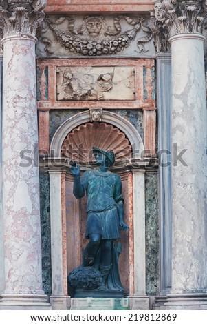 Statue near San Marco Campanile, Venice, Italy  - stock photo