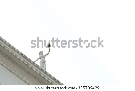Statue of a beautiful child that hold the flame torch and isolated on white background. - stock photo