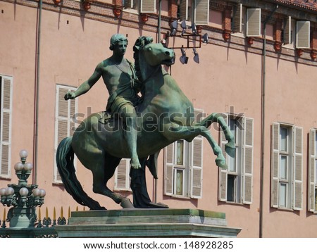 Statue of a goddess riding on a horse on the piazza castello in Turin in Italy