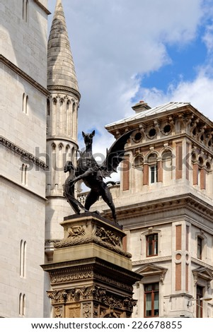Statue of a heraldic dragon in the city of London in front of Royal Courts of Justice