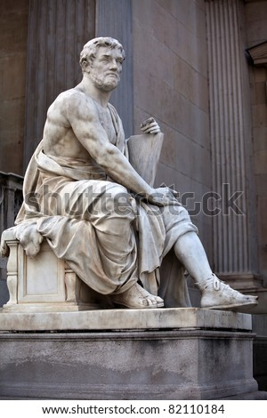 Statue of a history scholar in the ancient Greek style, situated in front of the building of Austrian Parliament. - stock photo